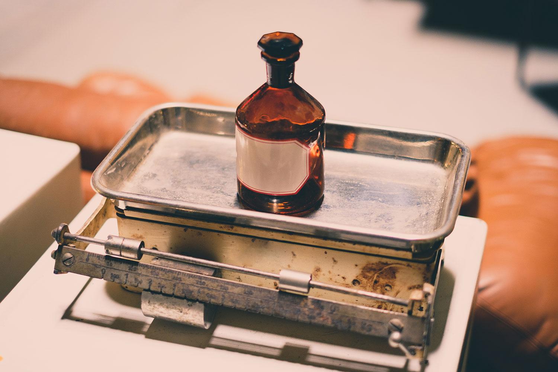 old empty medicine bottle on scale - vintage